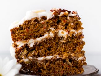 slice of carrot cake with cream cheese frosting on a plate